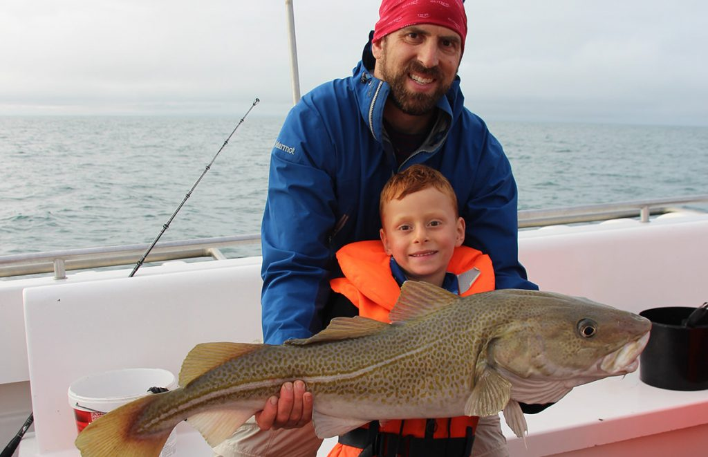 Father and son happy with a huge catch on a sea angling tour from Reykjavik